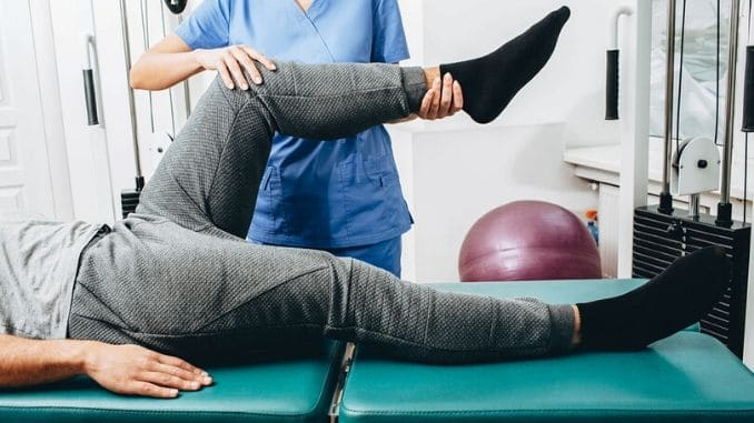 physiotherapist doing treatment exercise patients knee