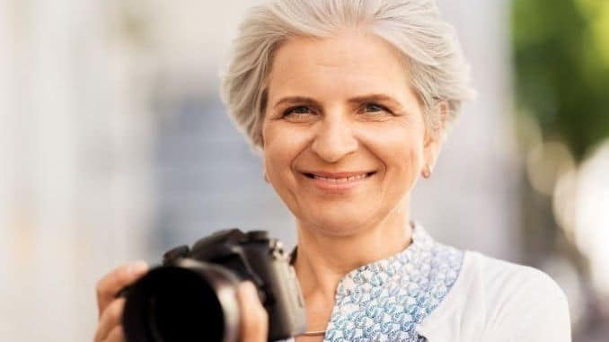 senior woman photographing