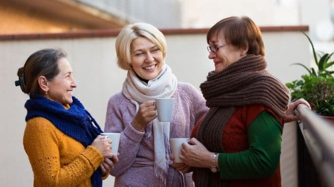 Mature women drinking tea
