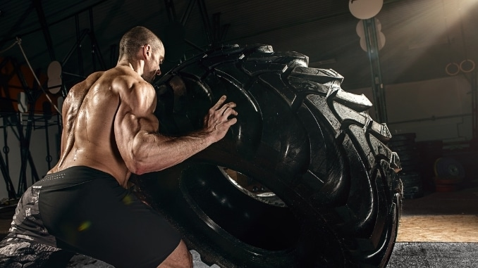 strong man flipping tire