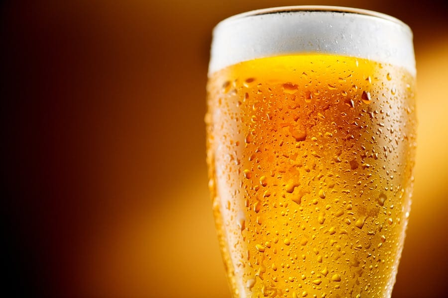 Beer. Cold Craft light Beer in a glass with water drops. Pint of
