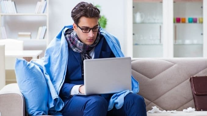 Sick businessman working from home due to flu sickness