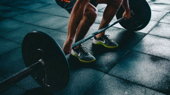 person-holding-barbell