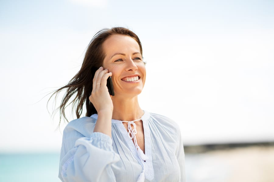 technology, people and leisure concept – happy smiling woman cal