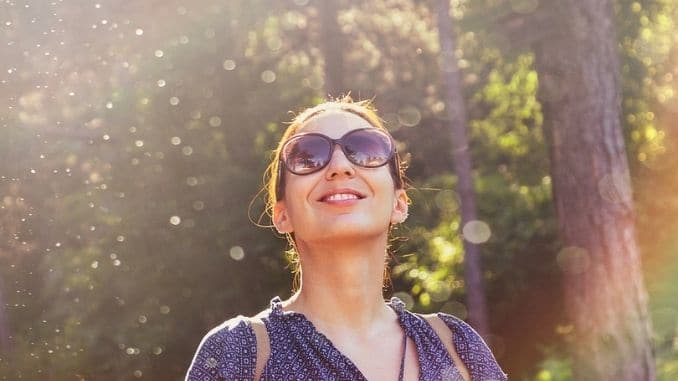 woman-smiling-in-nature