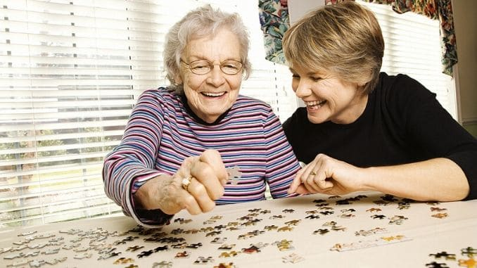 doing a puzzle in senior's home