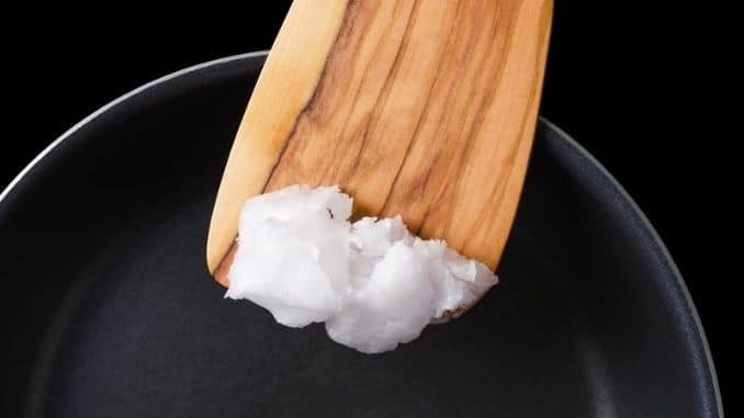 Coconut oil on wooden spatula