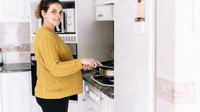 Pregnant woman cooking