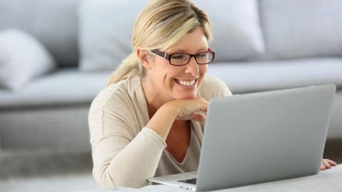 blond woman using laptop